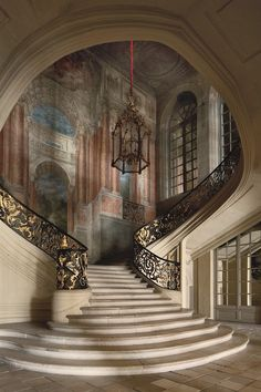 A staircase in the Hotel de Ville, located in Nancy, France. The building, the City Hall of Nancy, was built in 1755 and features ornate wrought-iron balustrades.