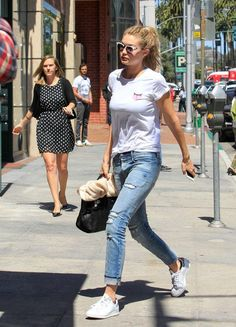 Gigi Hadid in RtA Ryder Boyfriend jeans with a graphic T-shirt and Adidas Stan Smith sneakers