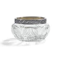 A Fabergé silver and cut-glass bowl, Moscow, 1908-1917, chased with elegant floral and foliate frieze, the bulbous bowl finely cut with square facets and leaves.