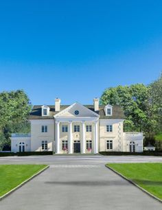 thehandbookauthority: thefoodogatemyhomework: Just beautiful, yellow stucco and white limestone giant neo-Georgian revival home on beautiful, sweeping grounds in Westchester, New York. Wonderful proportions.