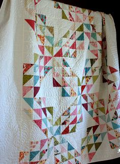 I am currently making this quilt - with far different colors. It will be for my 2 year old niece.
