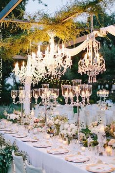Chandeliers mixed with greenery could also be a cool look over the head table maybe.  Do you like candelabras (and not necessarily theses) or no?