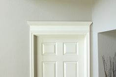 Making Your Doors Pretty With Molding (and a How-to)