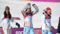 Women's Skiathlon Charlotte Kalla (SWE, left) and Marit Bjorgen (NOR, middle) and Heidi Weng (NOR, right) celebrate at the flower ceremony during the Sochi 2014 Olympic Winter Games at Laura Cross-Country Ski and Biathlon Center.
