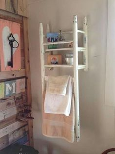 An old chair turned upside down and nailed to wall. Cool idea for towel rack.