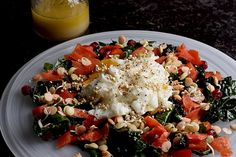 Lentil and quinoa sprouts top this simple early winter massaged kale salad, garnished with a poached egg.
