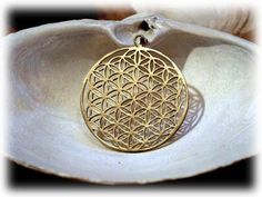Flower of life pendant gold - The Flower of life pendant is excellent for healing and it helps in connecting you to your higher self.  The flower of life shape contains a secret shape known as the fruit of life. It consists of 13 spheres that hold many mathematical and geometrical laws. These laws represent the whole universe. Giving the flower of life to someone is like giving them the whole universe in one jewel.