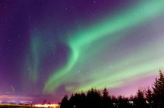 """""""Aurora in Reykjavik"""" by Thomas Burke, Washington DC //  // Imagekind.com -- Buy stunning, museum-quality fine art prints, framed prints, and canvas prints directly from independent working artists and photographers."""