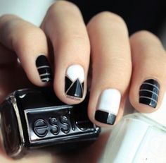 black, gold, and white geometric nails. essie