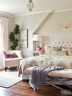 If+you+keep+the+room's+main+elements+neutral,+it+makes+it+a+cinch+to+switch+up+moods+on+a+whim.+In+this+bedroom,+for+example,+all+the+basics+are+classic,+comfortable+and+neutral,+including+the+pale+walls,+white+woodwork,+wood+floors,+and+white+tufted+headboard.+Changing+the+vibe+is+as+simple+as+changing+the+comforter+and+the+throw+pillows.