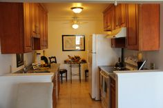 Updated kitchen with granite counters, custom cabinets, tile floors, and the appliances are included