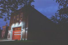 Our fire house lit at night.  Outdoor LED lighting. Barn Light Electric