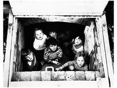 London children in a bomb shelter, c. 1940. Image by © CORBIS.
