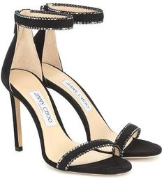 Understated yet decisively luxe, the Dochas sandals from Jimmy Choo feature opulent crystal embellishments along the ankle and toe straps. Crafted in Italy from black suede, they sit on a leg-lengthening stiletto heel. Stilettos, Stiletto Heels, Leather Wedge Sandals, Suede Sandals, Shoes Sandals, Black Heels, High Heels, Black Suede, Black Sandals