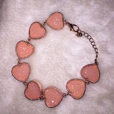 Charming Charlie Heart Bracelet So stinking cute, never been worn. Clasp is a bit hard to do yourself (at least that's why I'm selling it, but I do have big wrists too!) Charming Charlie Jewelry Bracelets