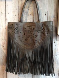Leather bag with fringes by Boots by M.