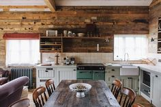 <strong>TOP CHEF</strong> | A Soho Farmhouse guest cabin with a fully equipped kitchen, including a Stoves oven custom-colored in Farmhouse green.