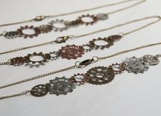 steam punk gear necklace - gear jewelry - steampunk necklace jewelry - mechanical jewelry - gear - gears by kristinalegath on Etsy https://www.etsy.com/listing/118832471/steam-punk-gear-necklace-gear-jewelry