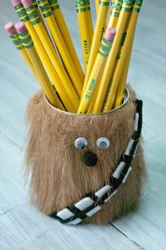 Chewbacca pencil holder! This would make a darling teacher gift. You could also do it for a Star Wars party craft as it is so easy to put together. Such a fun Chewbacca craft for your Star Wars fan!