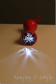 Halloween flashlight by Keeping It Simple. Easy to make on the Cameo Silhoette with vinyl - affordable supplies, tips and tricks available at www.crafterscornersupplies.com
