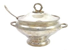 A silver twin handled soup tureen and cover, of circular form, decorated with beaded borders, raised on a circular foot, by Garrard & Co Ltd, London 1979, with a silver bead edge Old English pattern soup ladle, Sheffield 1984, combined weight 2190 gms.