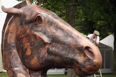 Artist Nic Fiddian-Green puts the finishing touches to his sculpture 'Copper Horse' as it is installed in the Royal Enclosure at Ascot Racecourse in England.