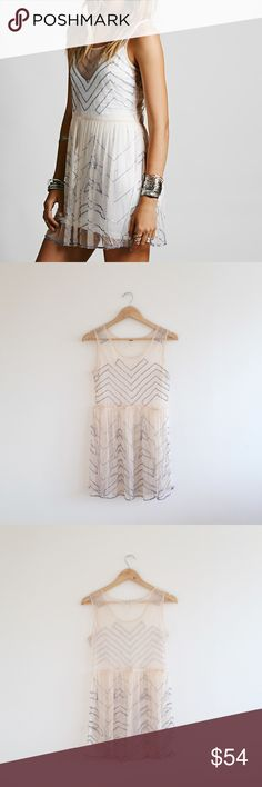Free People Beaded Slip Some loose threading in one area (see photo); otherwise great condition; no trades Free People Dresses