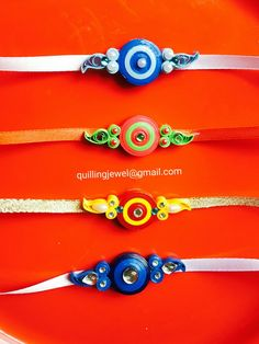 Simple quilling rakhi decorated with simple kundan Quilling Dolls, Quilling Videos, Paper Quilling Jewelry, Quilling Earrings, Quilling Techniques, Quilling Patterns, Quilling Designs, Quilling Art, Paper Jewelry