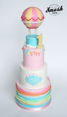 Hot Air Balloon cake, with pastel ruffles, bunting, and frame plaque nameplate.