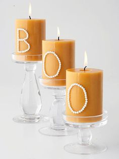 Line up basic pillar candles to spell out a spooky message. Hot-glue beads, rhinestones, or seeds into a letter shape on each candle, then place the candles on candlesticks of varying heights.