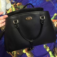 """Firm price! Coach small Margot carryall Small Margot carryall in leather. Color: black can be crossbody or shoulder bag. I'm considering selling this bag which was used max 3 times. It's really very elegant and cannot be found anymore on coach. Size length 13 3/4"""" h 6"""" w 6"""" handle drop is 3 3/4"""" shoulder strap 20"""" Coach Bags"""