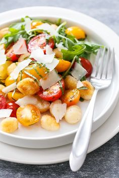 You'll love this quick & easy salad made with crispy pan-fried gnocchi and heirloom cherry tomatoes, tossed with a splash of vinegar, fresh basil, and shaved Pecorino cheese.