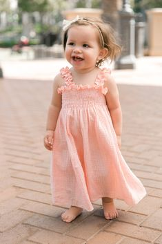Eeek! Look at her little bare feet! Love this adorable baby/toddler maxi dress! Sweet peach color for spring and summer. Peach Smocked Ruffle Trim Baby Maxi Dress #ad #baby #pinkblush #maxidress #kidsclothing #style #babygirl #girl #spring #summer