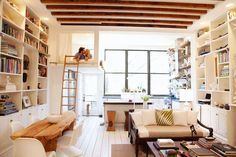 two walls of bookshelves, wood beam ceiling, bright colour palette, bed loft