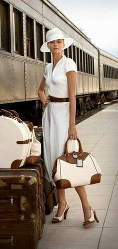 White Short Sleeve A-Line Midi Dress, Brown Belt, White Pumps with Brown Cap Toe, White Sunhat Brown and White Bag.