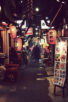 A narrow street in Tokyo with plenty of restaurants