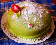 One of the most traditional desserts in Sweden is Swedish Princess Cake. The original recipe has been around since 1930 and it consists of alternating layers of sponge cake, raspberry jam, whipped cream, and a thick pastry cream and topped with a layer of green marzipan. It's eaten during all of the Swedish national holidays, including Swedish National Day.