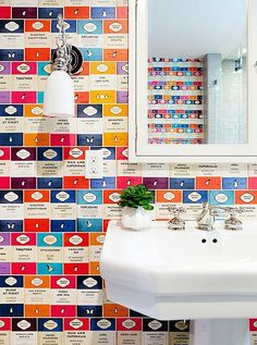 Another way to go bold in a small bathroom is to get cheeky with unexpected artwork or patterns. This wallpaper printed with Penguin book covers, for instance, is guaranteed to inspire a smile.