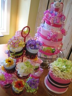 Diaper cake and diaper cupcakes. Really cute.
