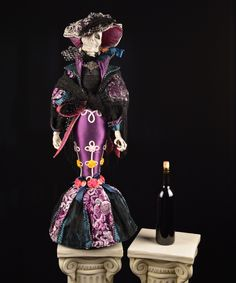 """Consuelo De Muerte Doll - Katherine's Collection. The vibrant colors and the beautiful detail of this figure make it a Drop Dead Gorgeous masterpiece!  From that incredible hat to the perfectly designed fit of her dress, Consuelo De Muerte is a must-have for your collection.  34"""" tall.  FREE SHIPPING!"""