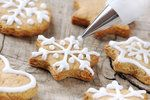 christmas cinnamon cookies icing decorating process with a pastry bag Cinnamon Stars Recipe, Cinnamon Cookies, Sugar Cookies, Holiday Cookie Recipes, Holiday Cookies, Holiday Meals, Gluten Free Gingerbread Cookies, National Cookie Day, Milk Ingredients