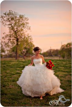 Maggie Sottero gown in a field at sunset = bridal beauty