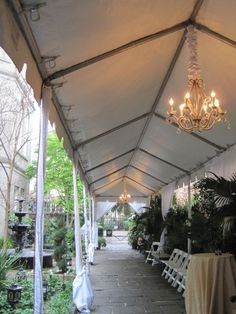 Walkway with chandeliers and tent