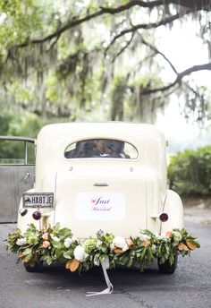 "Vintage limousine, white car, floral garland on the bumper, ""Just Married"" getaway car // Jade and Matthew Take Pictures"