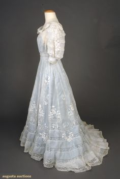 """EMBROIDERED LACE TEA GOWN, c. 1905  Fine cotton batiste w/ Val lace insertions & raised floral allover embroidery, back buttons, Sh-Sh 17"""", B 38"""", W 25"""", L 55""""-63"""", (1.5"""" tear on skirt back) good."""