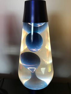 Blue wax and clear liquid on a metallic blue base. Beauty Salon Logo, Hair And Beauty Salon, Fluorescent Lamp, Metallic Blue, Modern Bedroom, Wax, Table Lamp, Lights, Bedroom 2018