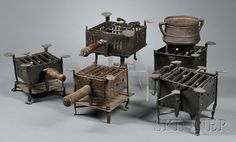 Five Wrought Iron Camp Stoves and a Footed Pot with Handles, 18th and early 19th century, of various designs, all with hinged cooking grates, wooden handles (one lacking handle), and decorative feet, average dimensions, 8 by 8-in., iron cooking pot accompanies the lot.