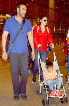 Ajay Devgn and wife Kajol with son Yug at Mumbai airport. #Bollywood #Fashion #Style #Beauty #Handsome