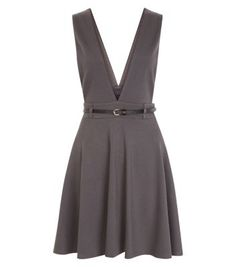"""Wear this deep V pinafore skater dress with a turtle neck long sleeve top for work wear styles. Try finish with block heel ankle boots.- Deep V neckline- Sleeveless design- Belted waist- Casual fit that is true to size- Mini length- Model is 5'8""""/176cm and wears UK 10/EU 38/US 6"""