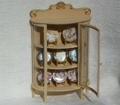 8 new patterns of mini China in Cabbage Rose patterns displayed in a beautiful Victorian China cabinet, embellished with 18K gold. Available at www.ninasminicreations.com